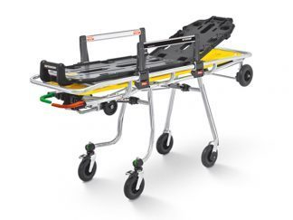 Kompakt självlastande ambulansbår